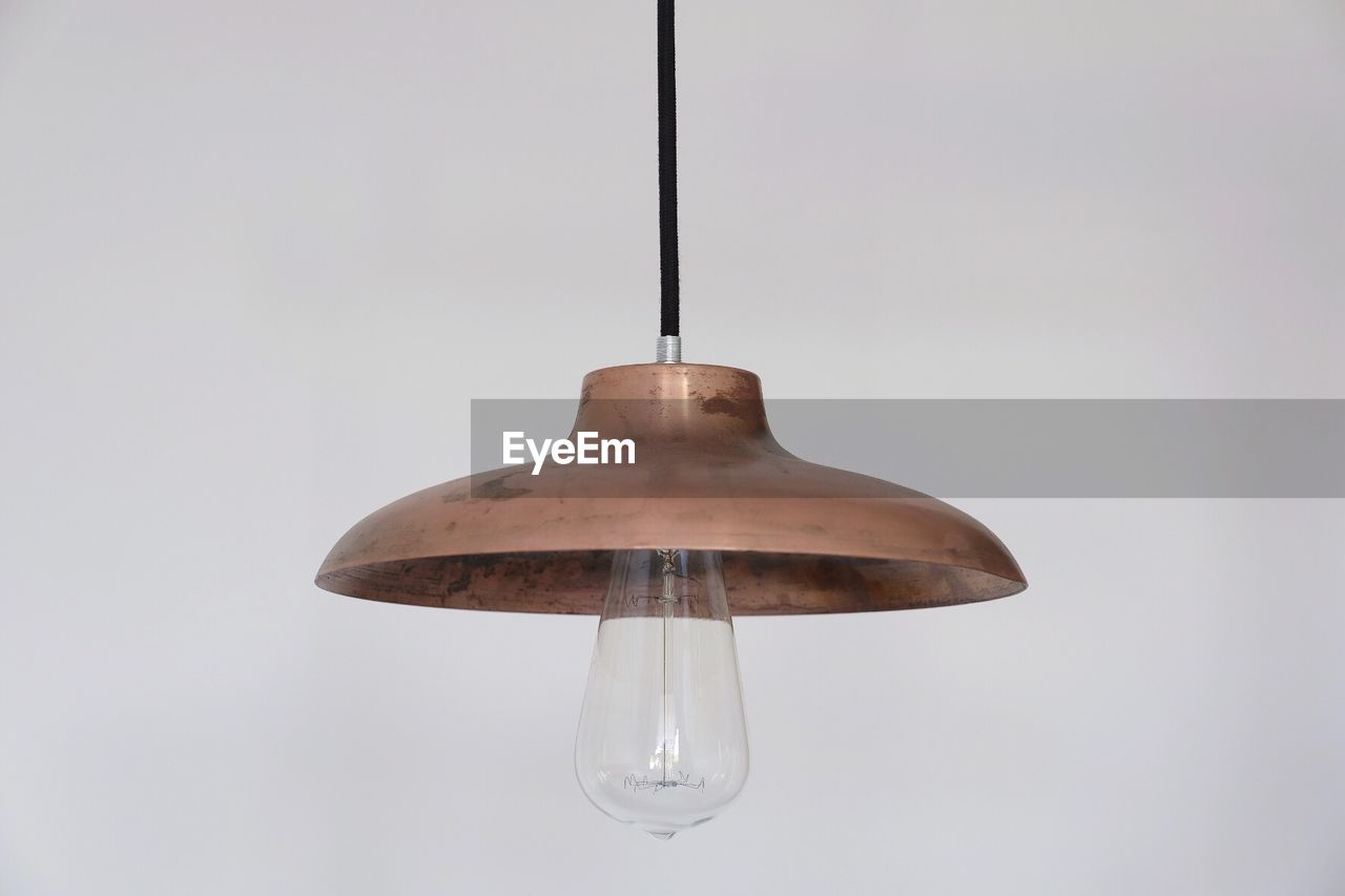 hanging, indoors, no people, studio shot, close-up, white background, single object, lighting equipment, low angle view, electricity, metal, copy space, transparent, wall - building feature, focus on foreground, water, light bulb, equipment, light, electric lamp, ceiling