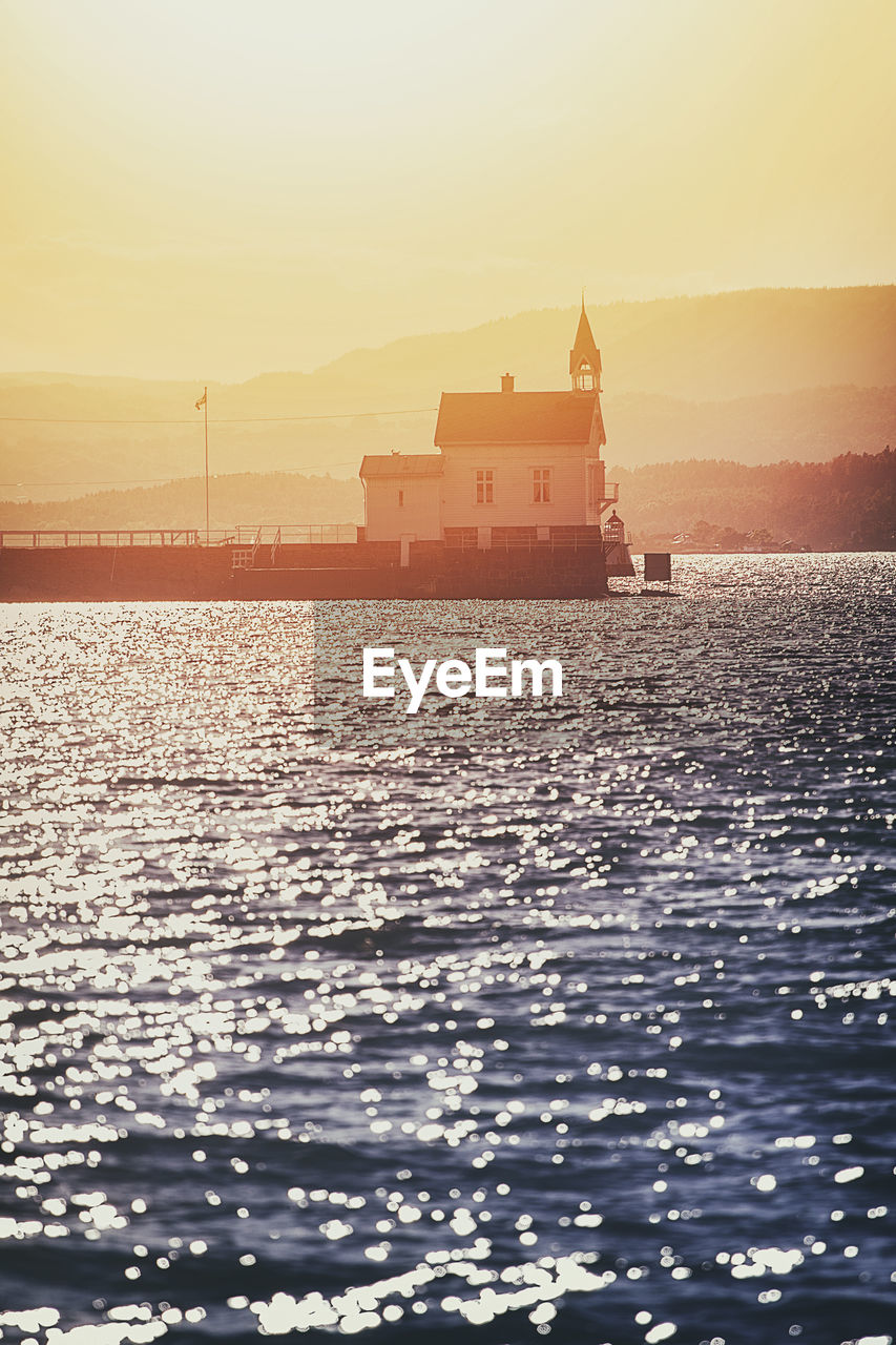 water, sky, architecture, built structure, waterfront, sea, building exterior, nature, building, sunset, no people, transportation, beauty in nature, scenics - nature, rippled, outdoors, mode of transportation, nautical vessel, place of worship, passenger craft