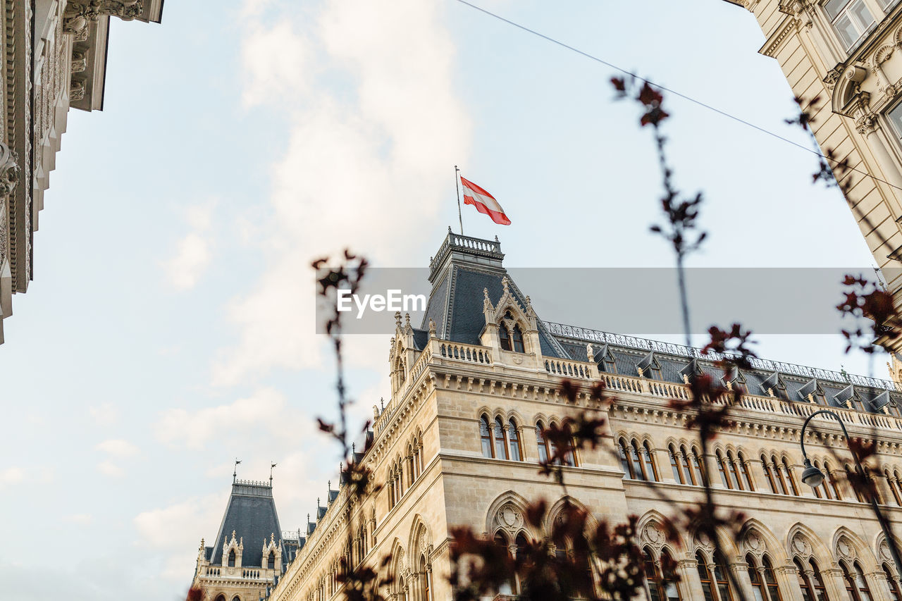 architecture, building exterior, built structure, sky, flag, city, travel destinations, low angle view, cloud - sky, building, day, nature, patriotism, travel, tourism, no people, outdoors, history, government