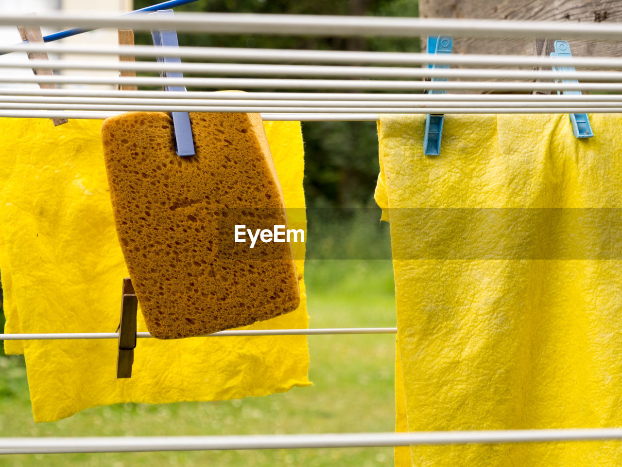 Close-Up Of Napkins And Sponge Hanging On Clothesline