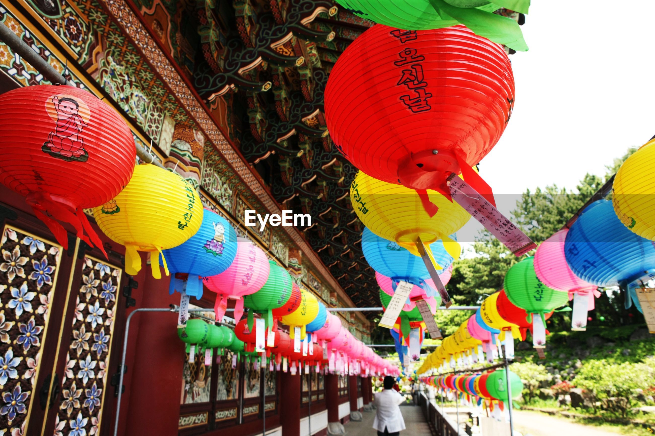 LOW ANGLE VIEW OF TRADITIONAL LANTERNS