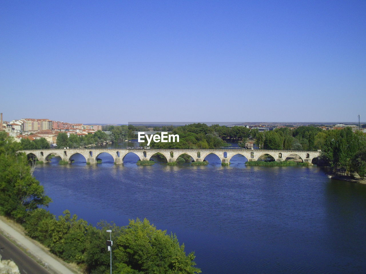 bridge, built structure, architecture, connection, sky, bridge - man made structure, copy space, water, transportation, arch, nature, clear sky, river, blue, arch bridge, tree, plant, no people, day, outdoors, arched
