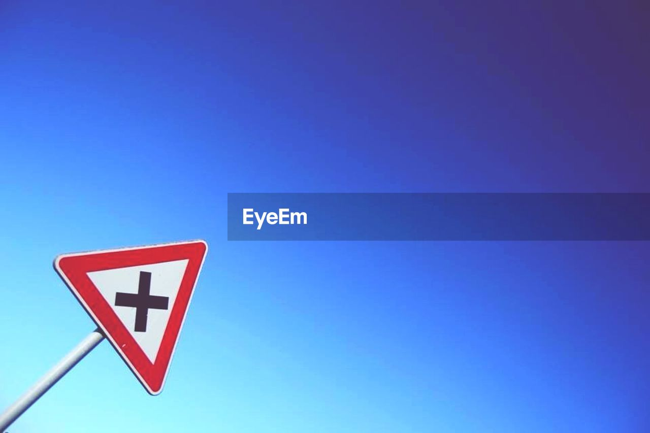 road sign, blue, copy space, communication, safety, low angle view, no people, red, clear sky, day, outdoors, close-up, sky