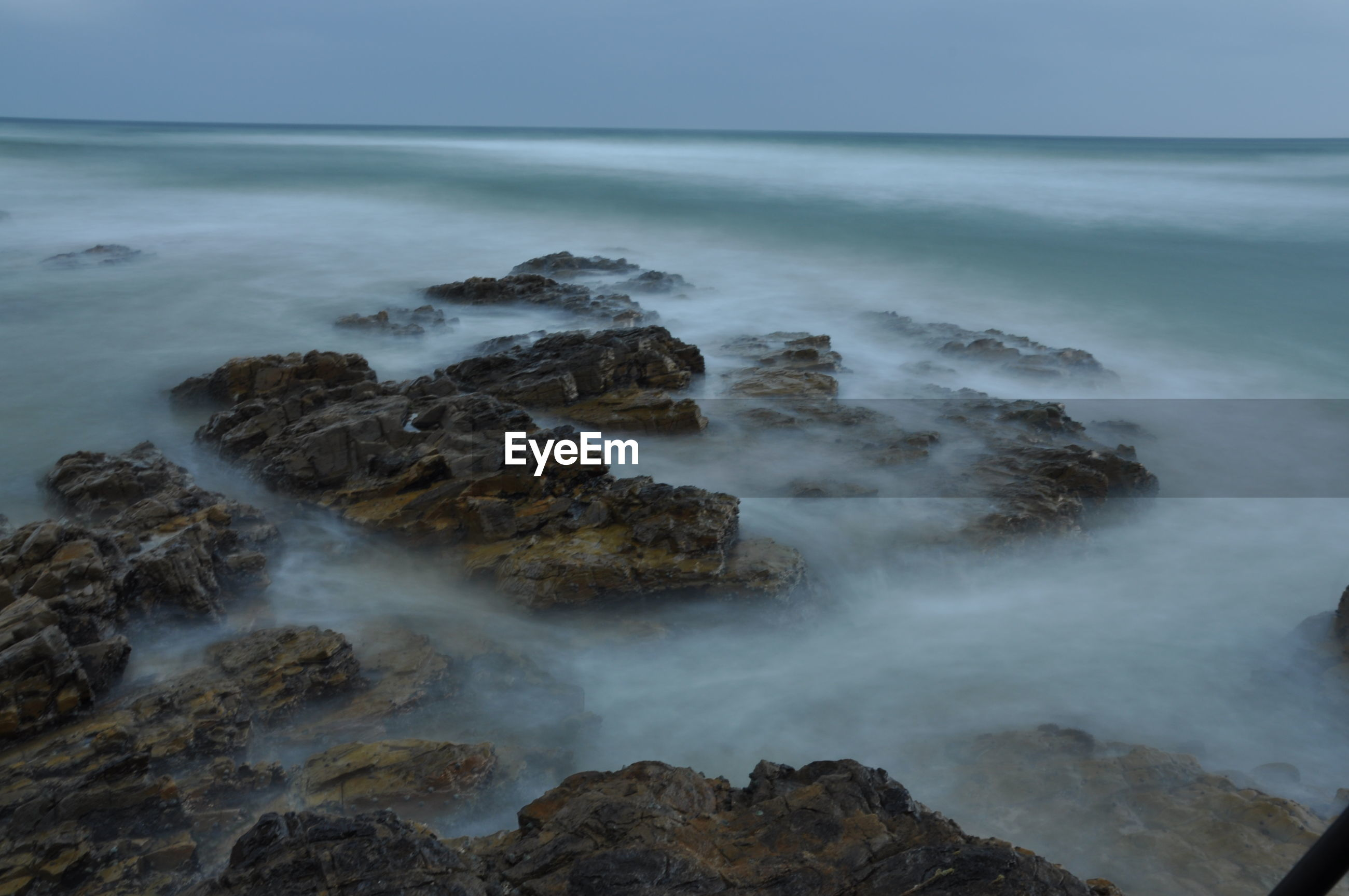 Scenic view of sea against overcast sky