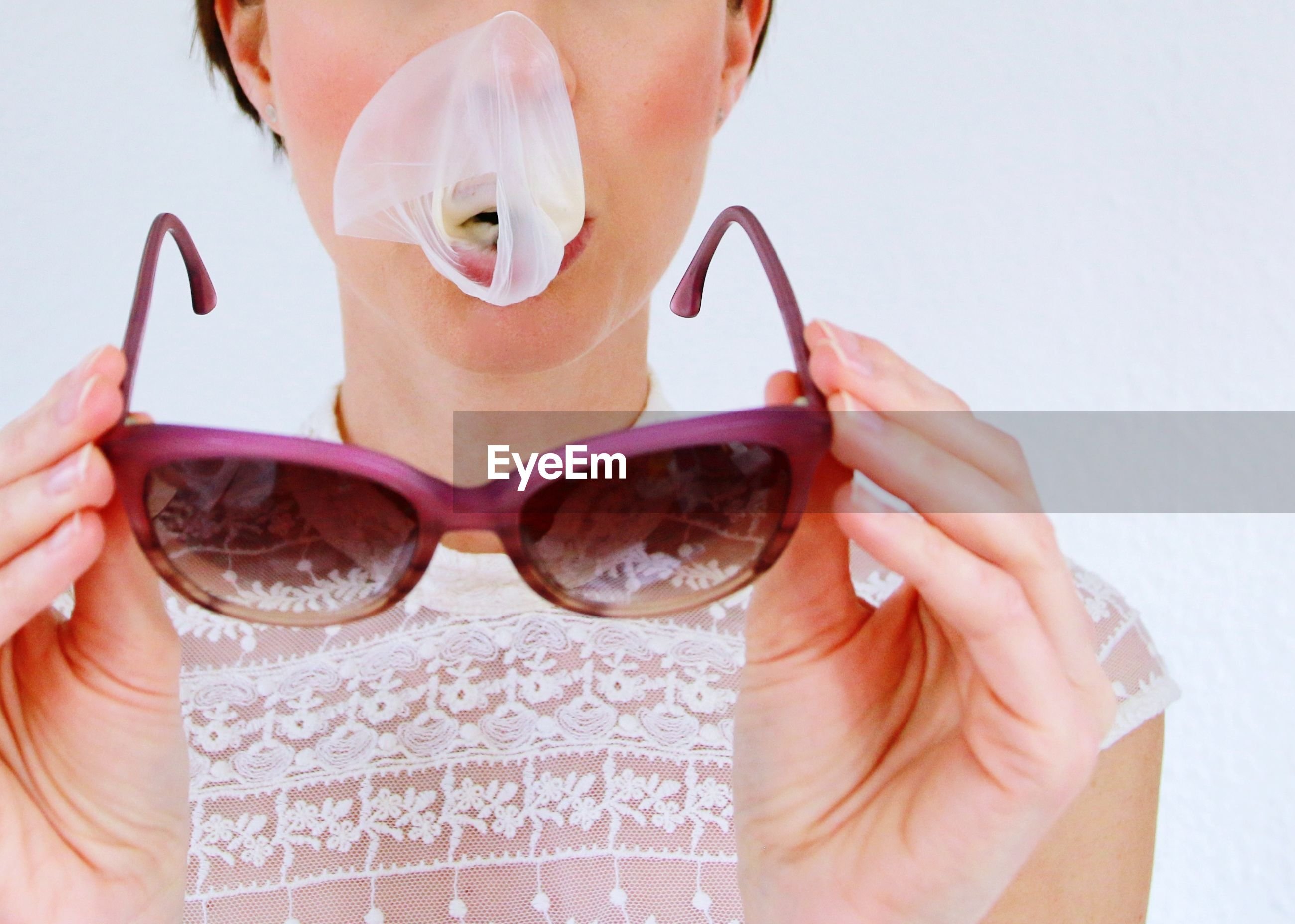 Midsection of woman holding sunglasses