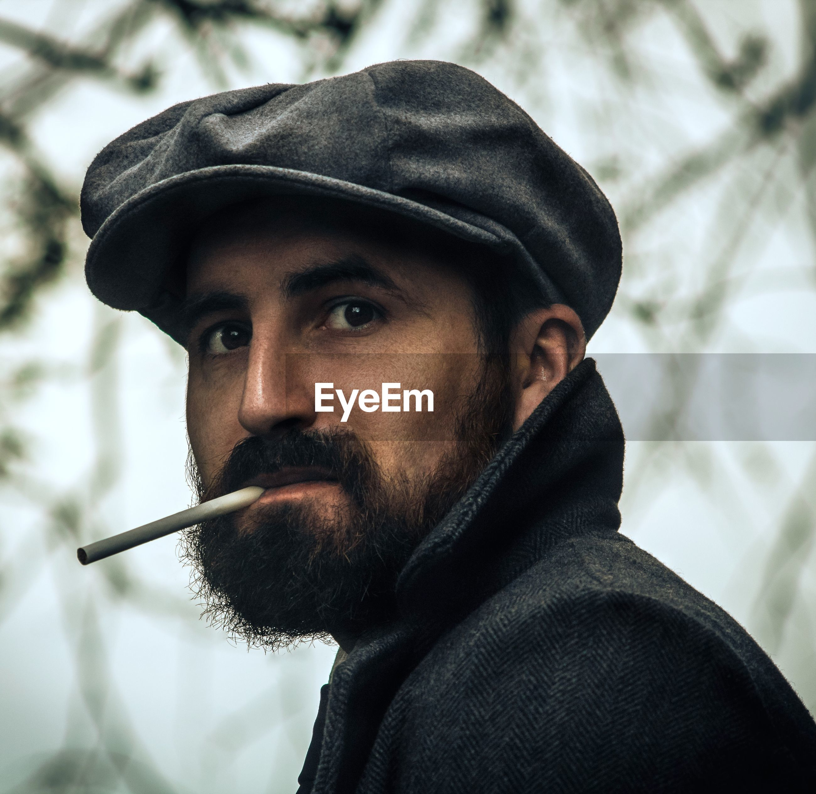 Man holding cigarette in mouth