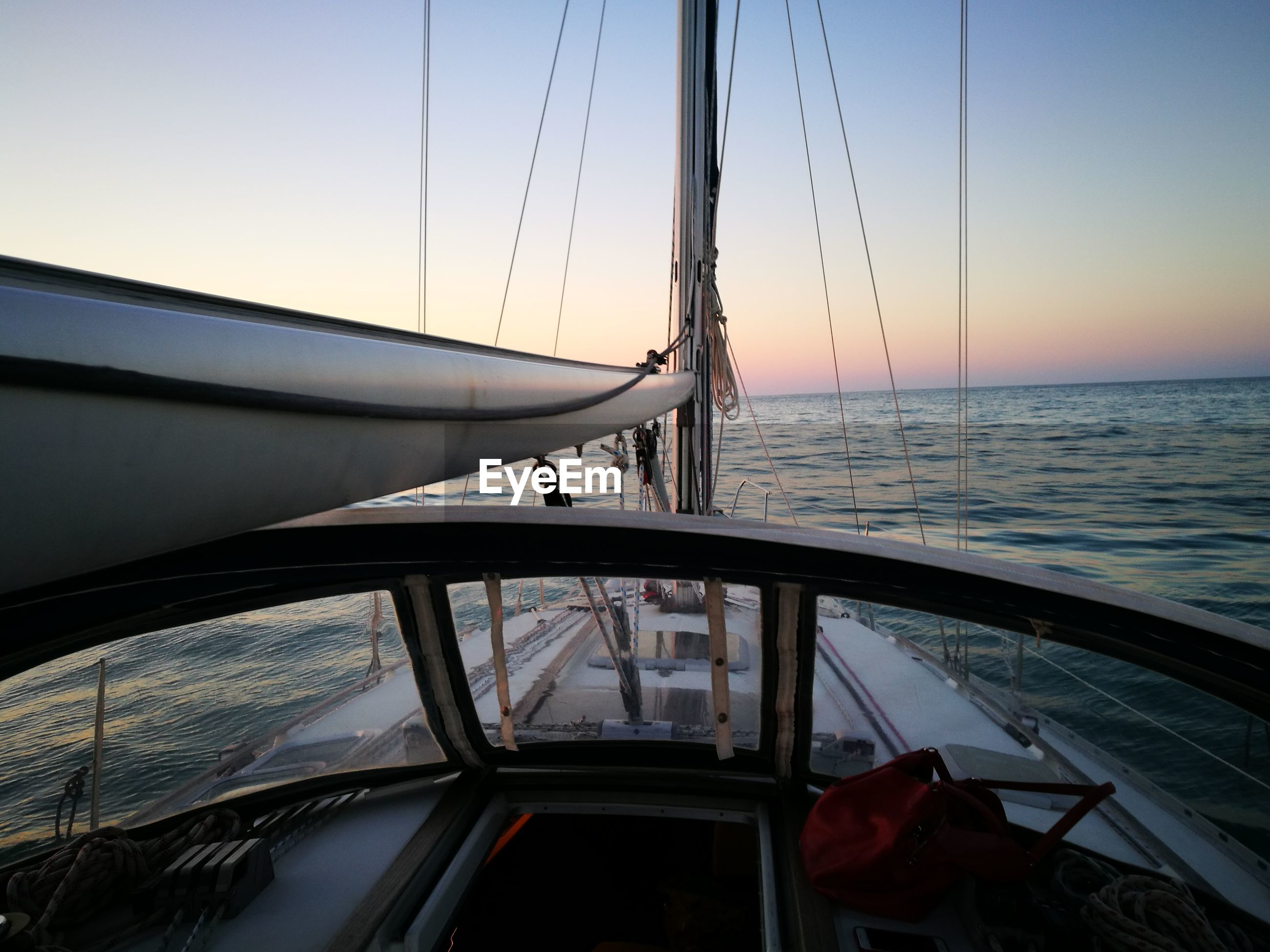 sea, transportation, nautical vessel, mode of transport, nature, sunset, scenics, water, horizon over water, sky, no people, outdoors, beauty in nature, sailing, sailboat, clear sky, mast, day, yacht