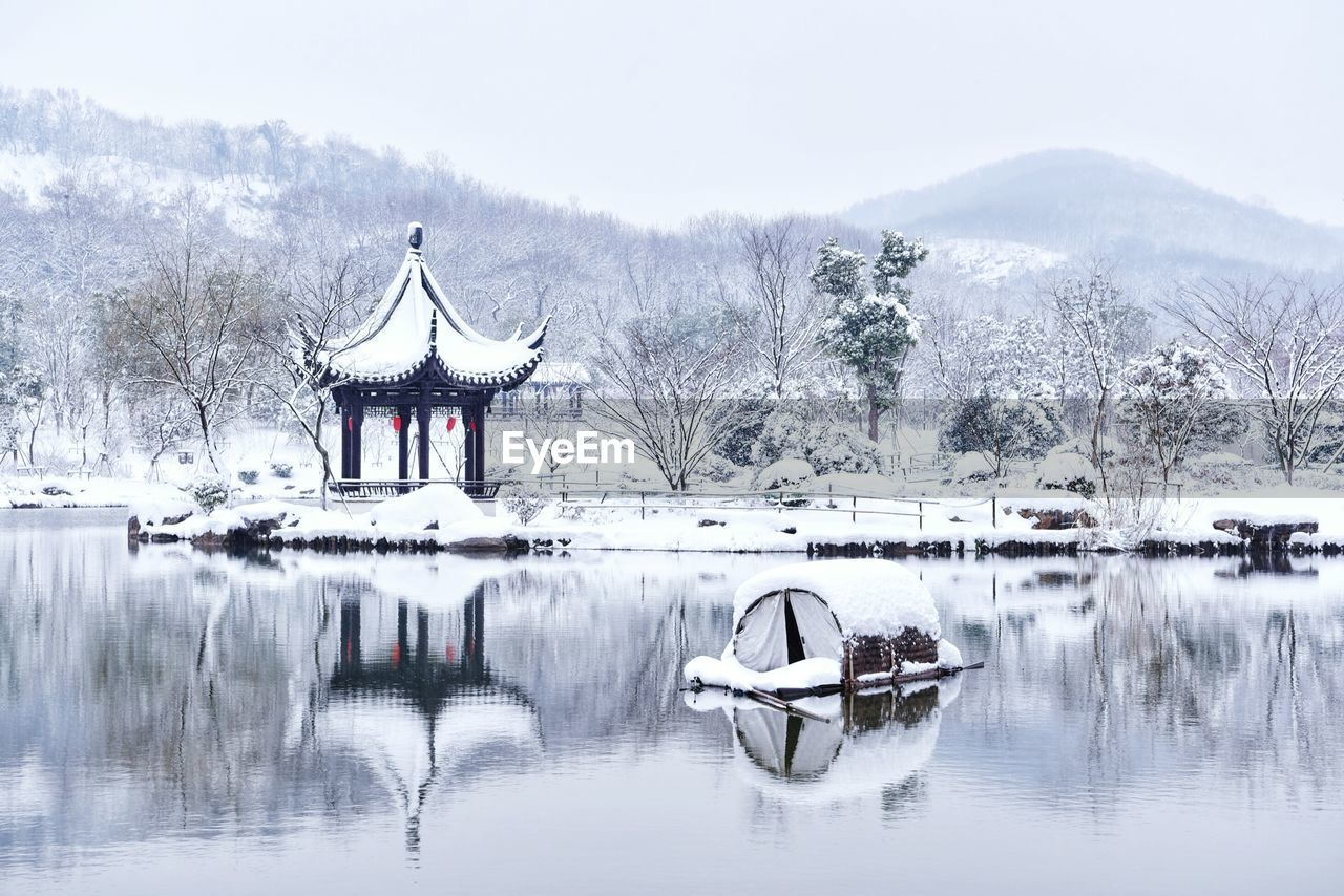 winter, cold temperature, snow, nature, tree, weather, lake, outdoors, reflection, beauty in nature, bare tree, water, day, frozen, scenics, waterfront, no people, sky, architecture