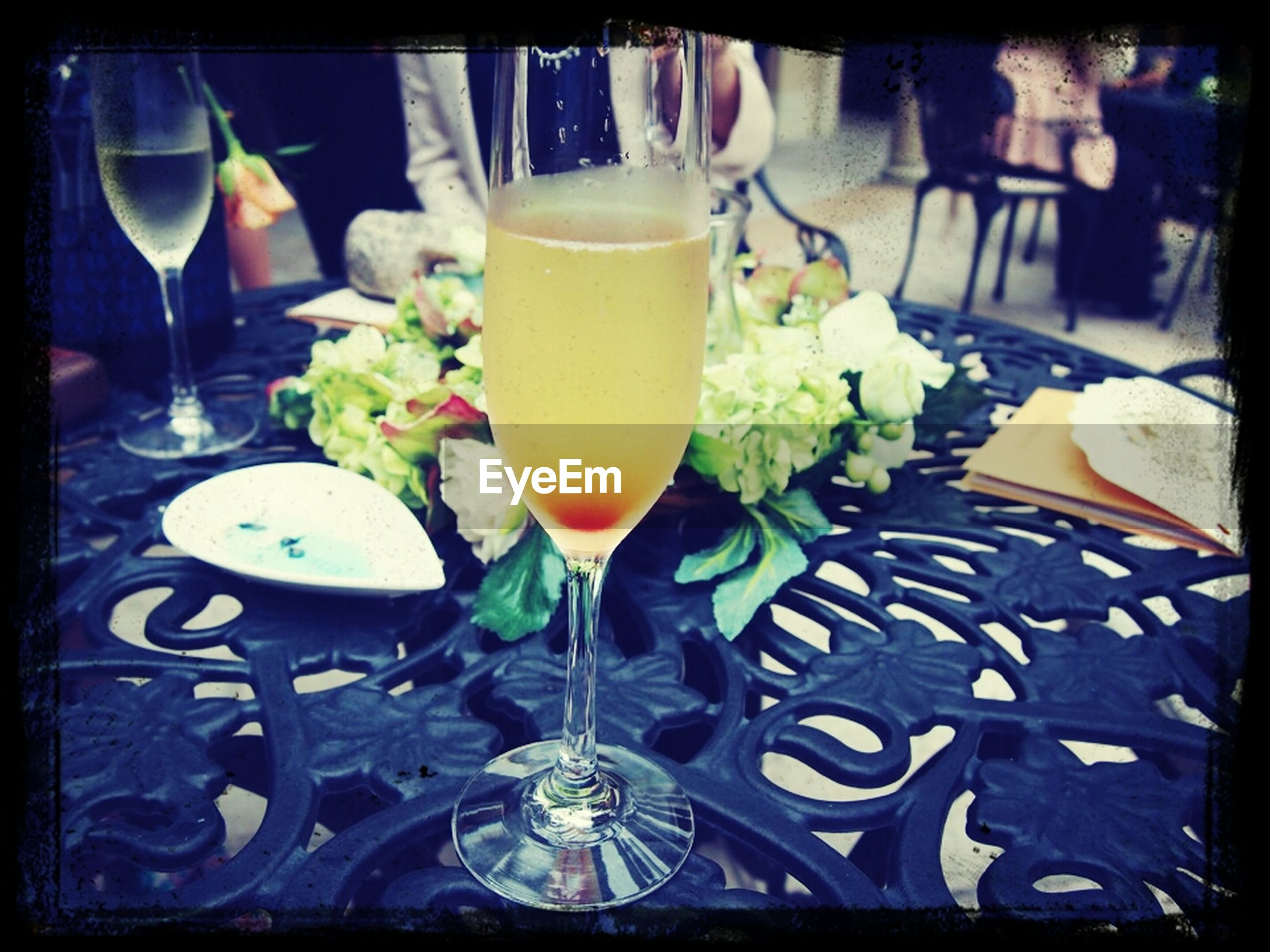 transfer print, food and drink, indoors, drink, drinking glass, table, auto post production filter, freshness, refreshment, still life, restaurant, glass - material, close-up, food, glass, healthy eating, wineglass, alcohol, plate, high angle view