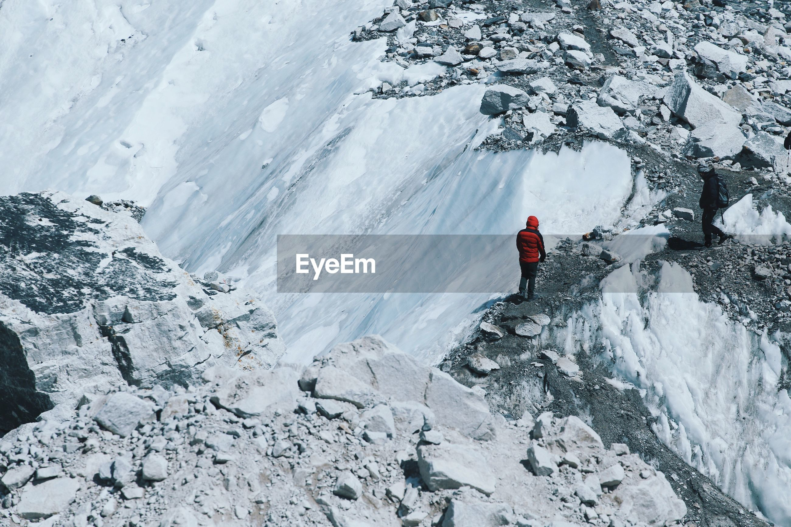 Person standing on barren landscape