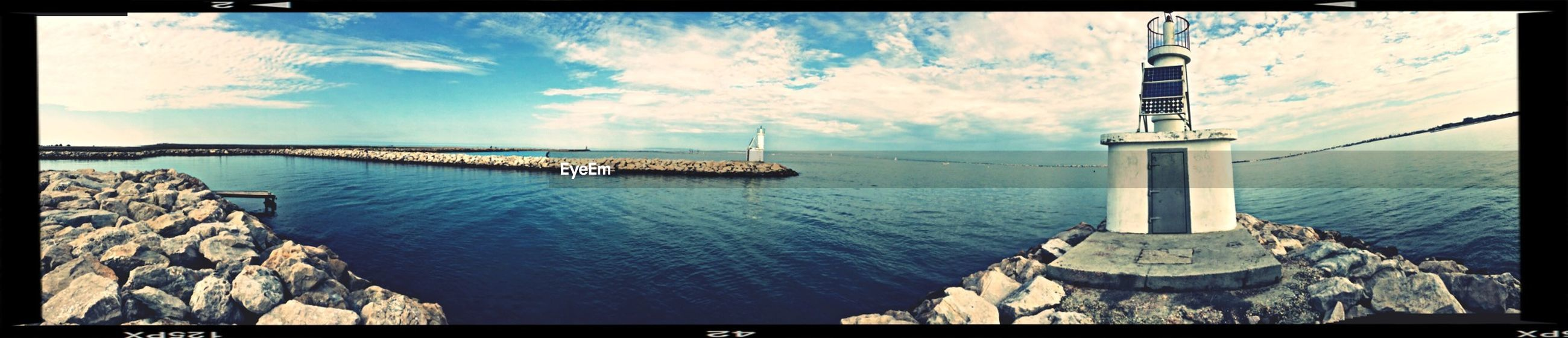 transfer print, water, sky, auto post production filter, sea, nautical vessel, transportation, cloud - sky, boat, cloud, tranquility, mode of transport, tranquil scene, nature, blue, scenics, panoramic, waterfront, beauty in nature, built structure