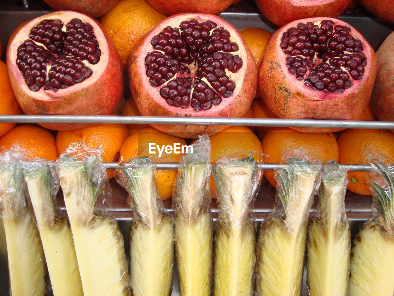 High angle view of pomegranates and orange fruits at store for sale
