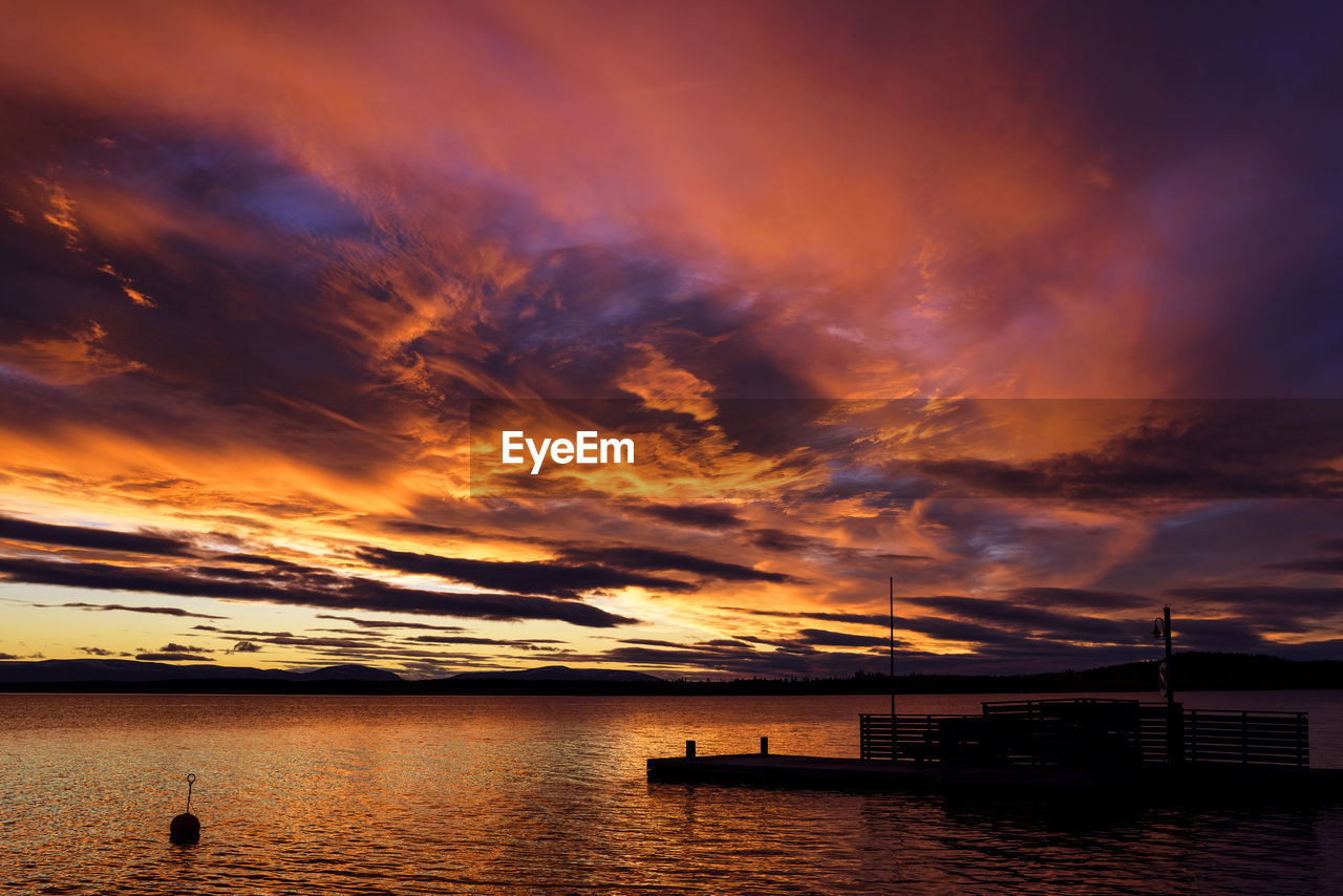 cloud - sky, sky, water, sunset, beauty in nature, sea, scenics - nature, orange color, nature, tranquil scene, no people, tranquility, idyllic, dramatic sky, silhouette, transportation, waterfront, architecture, nautical vessel, outdoors
