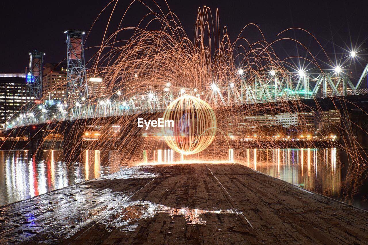 Fireball Created With Steel Wool By Illuminated Hawthorne Bridge At Night