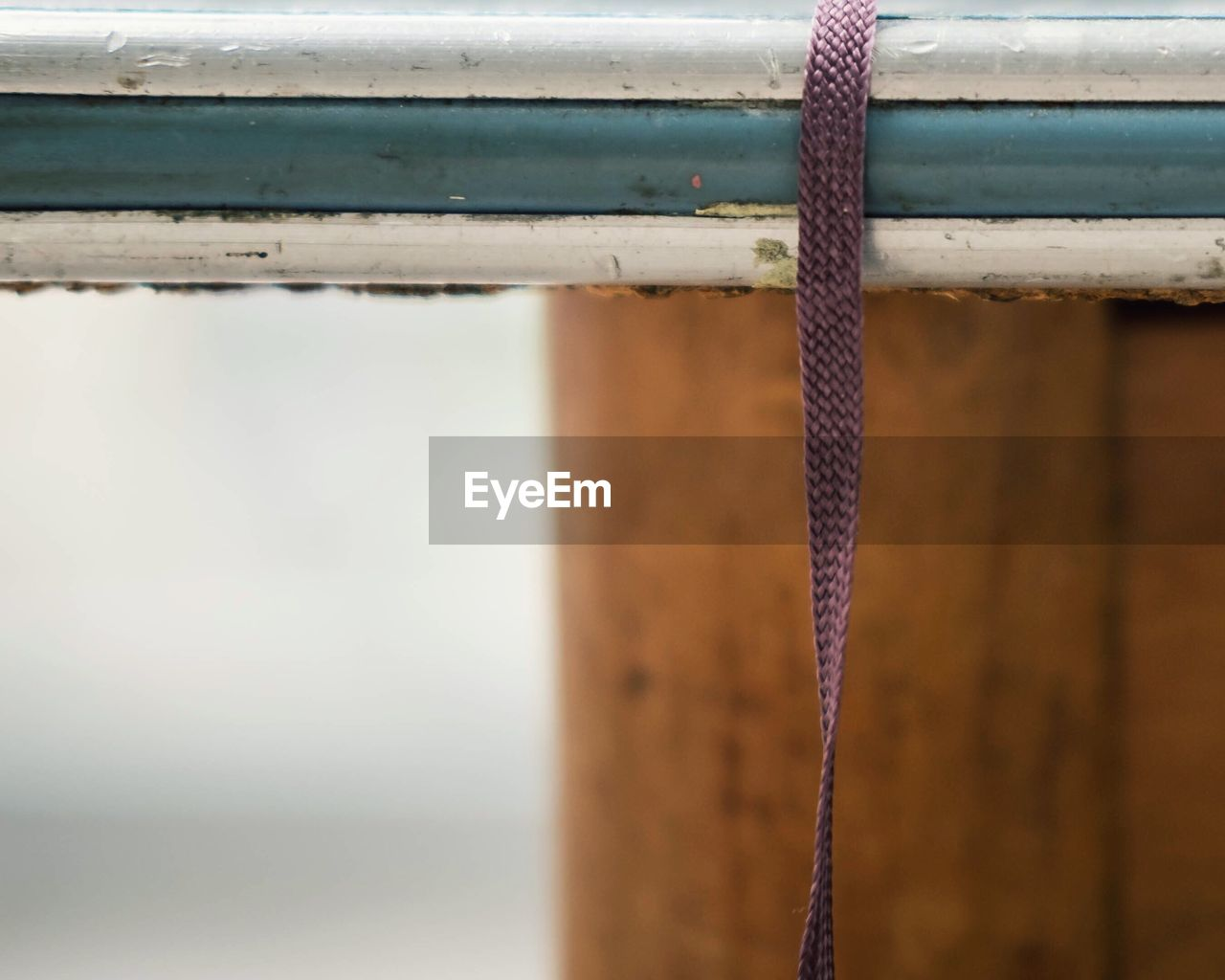 Close-up of strap on railing