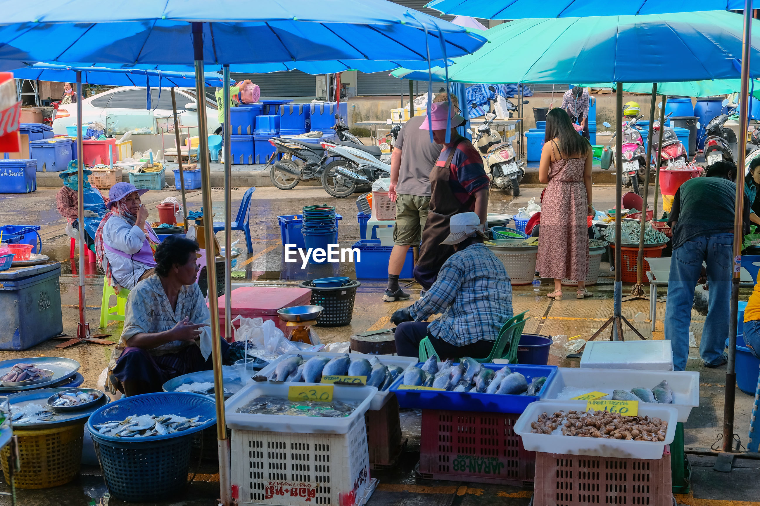 GROUP OF PEOPLE IN MARKET STALL