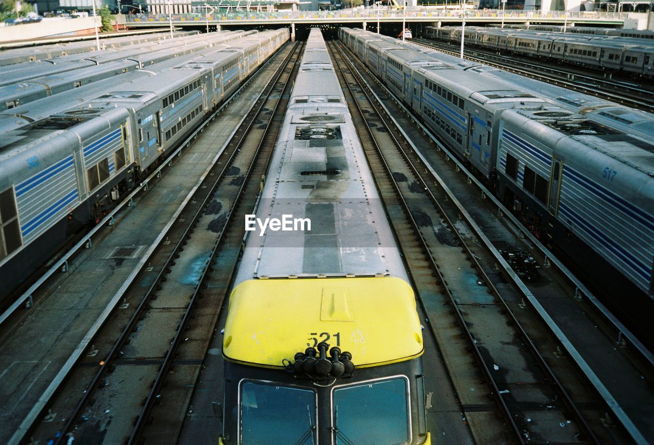 transportation, rail transportation, mode of transportation, track, railroad track, train - vehicle, train, public transportation, high angle view, railroad station, architecture, railroad station platform, travel, yellow, no people, outdoors, day, passenger train, land vehicle, built structure, station, shunting yard, arrival