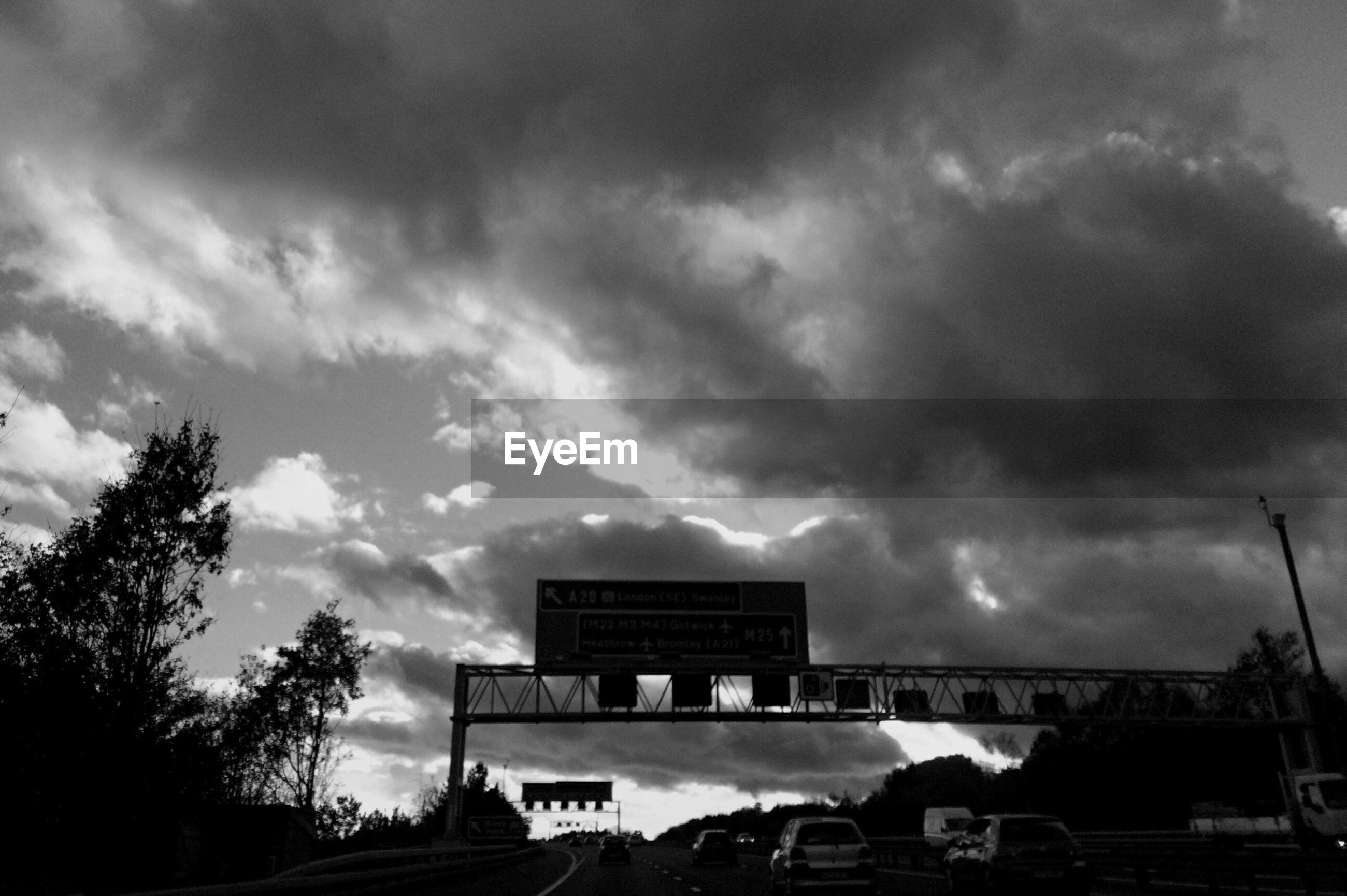 sky, cloud - sky, cloudy, built structure, weather, overcast, architecture, building exterior, cloud, storm cloud, low angle view, tree, outdoors, dramatic sky, cloudscape, transportation, nature, railing, house, dusk