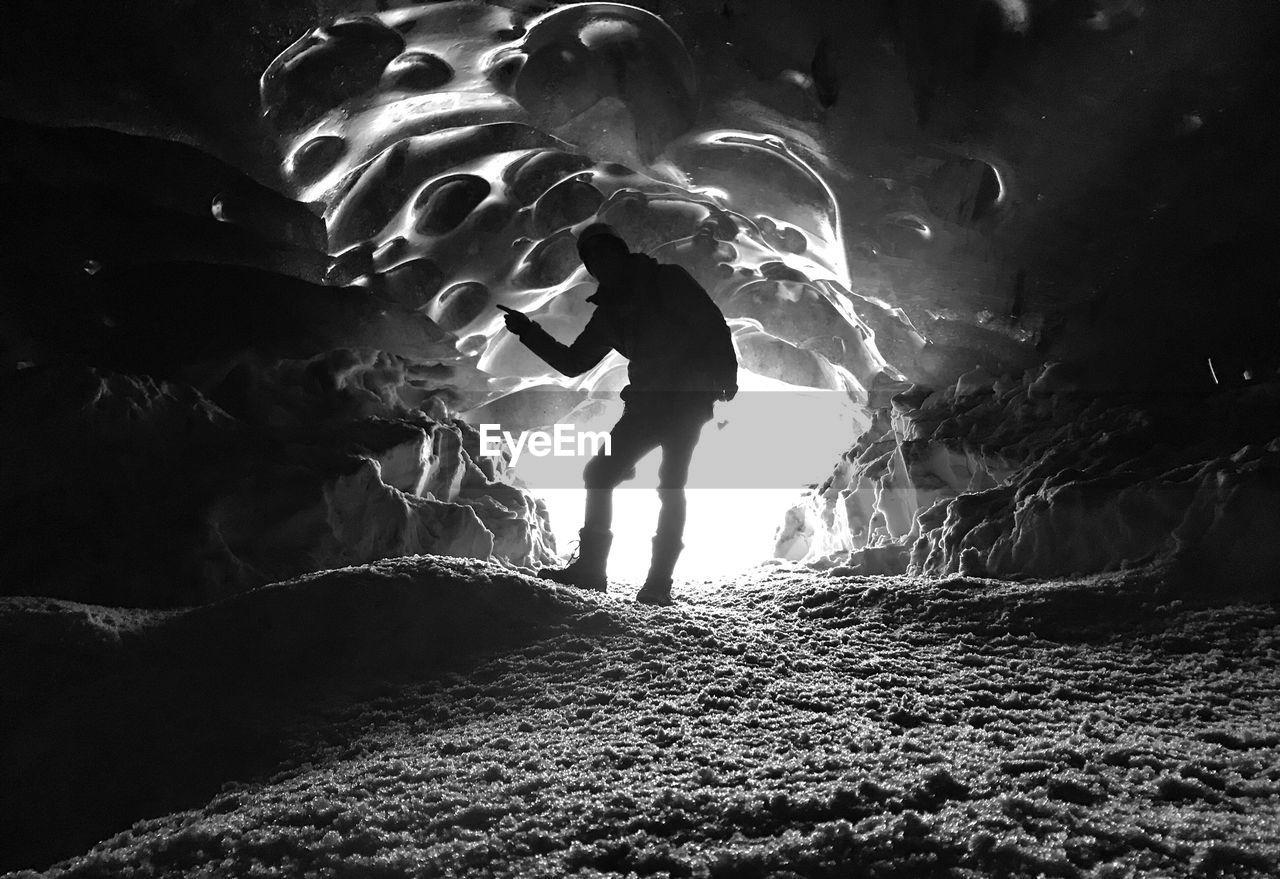 Man Walking In Cave