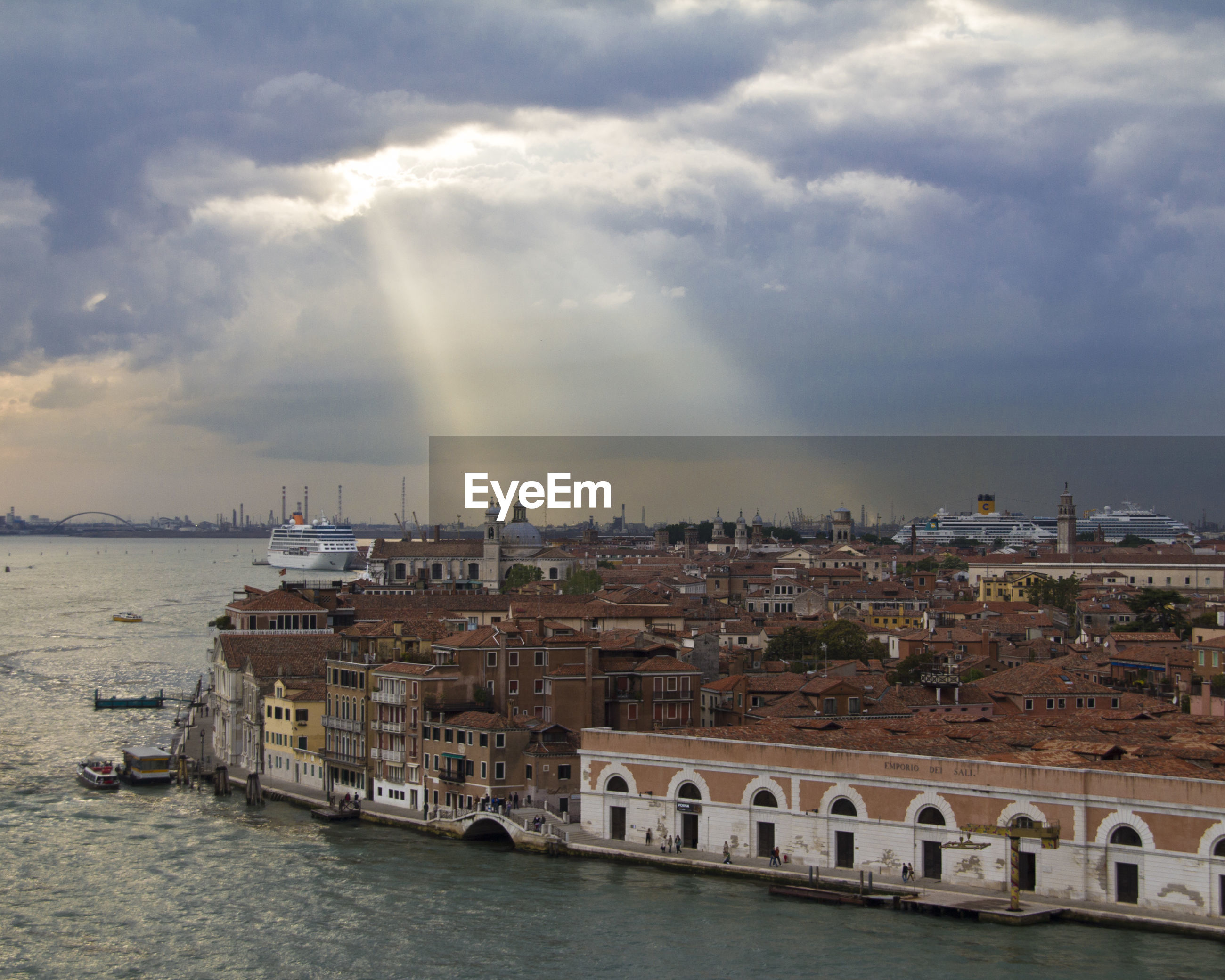High angle view of island by grand canal against cloudy sky