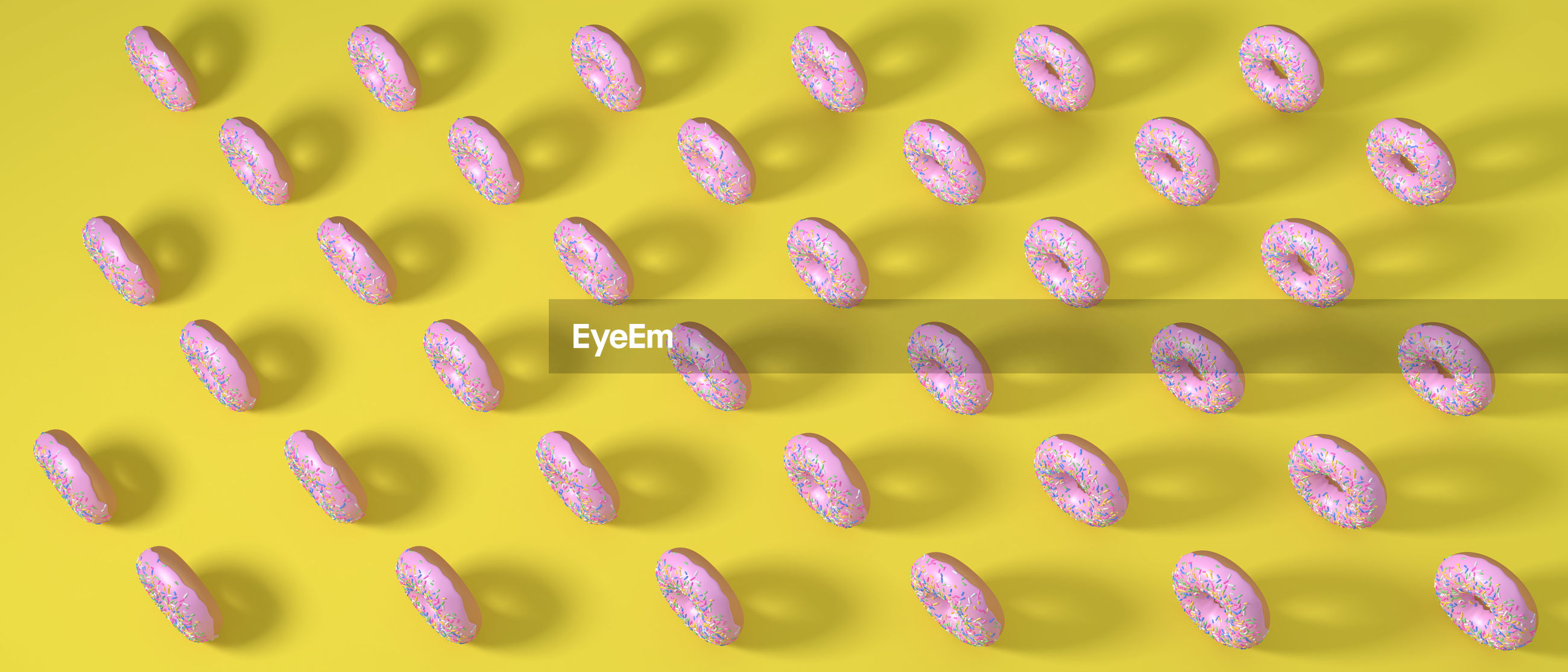 High angle view of donuts on yellow background