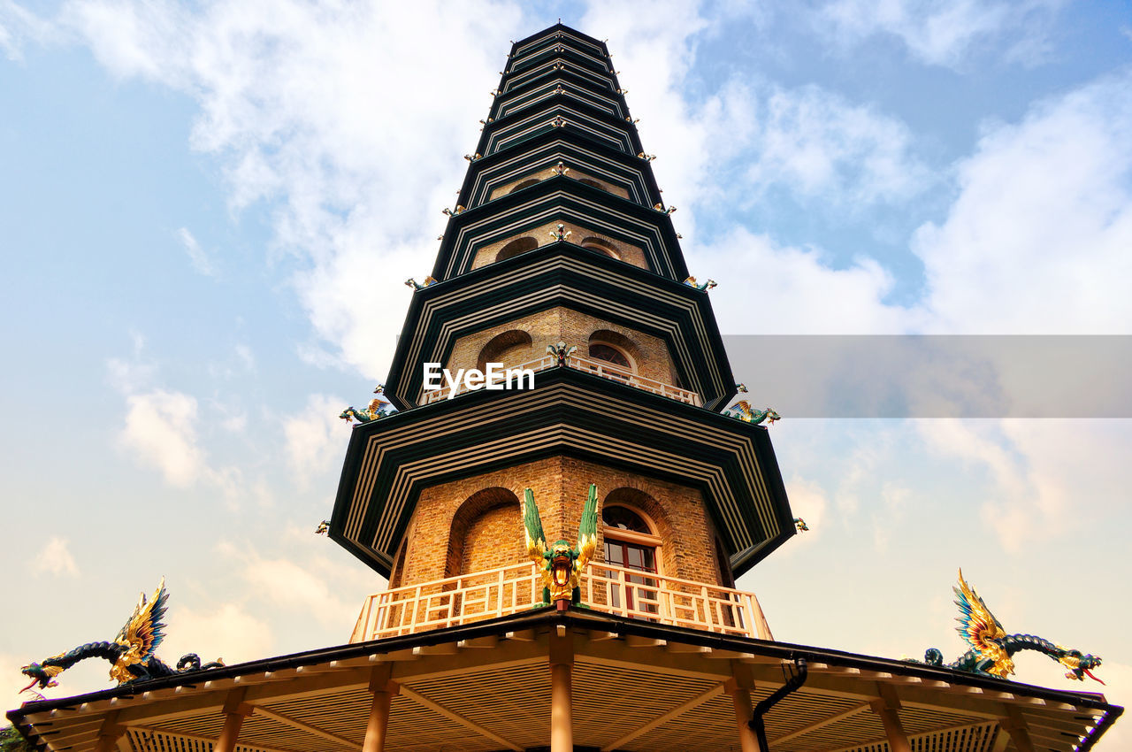 low angle view, cloud - sky, sky, built structure, architecture, building exterior, religion, place of worship, spirituality, belief, nature, building, day, no people, tower, travel destinations, the past, outdoors, history, ornate, spire