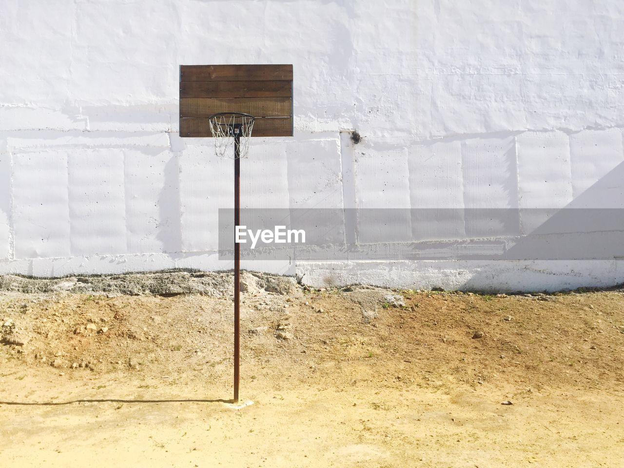 Basketball Hoop Against White Wall