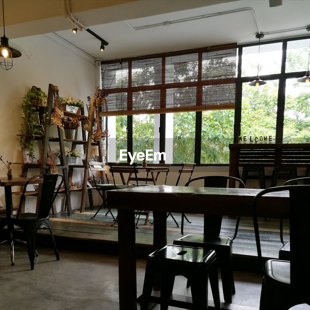 seat, window, table, indoors, chair, absence, no people, furniture, empty, day, business, restaurant, glass - material, ceiling, wood - material, domestic room, flooring, transparent, lighting equipment, setting
