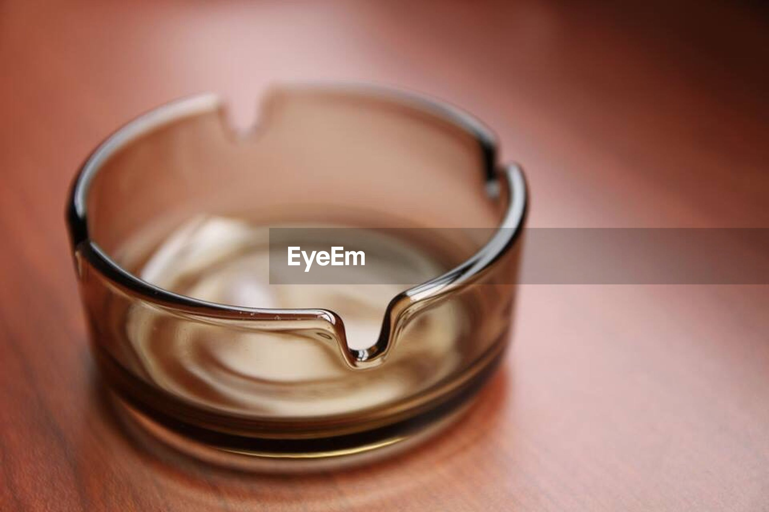 indoors, close-up, still life, table, single object, refreshment, drink, no people, high angle view, food and drink, home interior, focus on foreground, coffee cup, selective focus, simplicity, spoon, two objects, freshness, metal, container