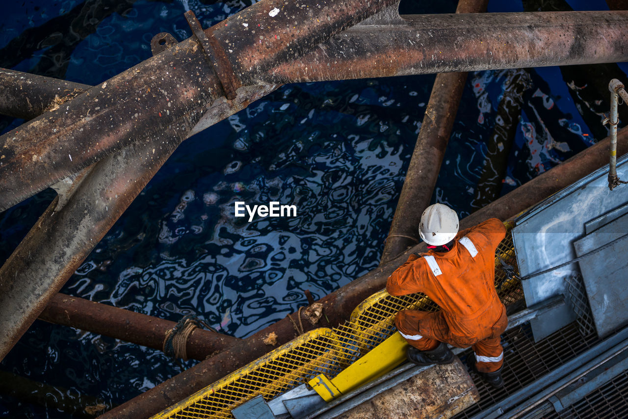 High Angle View Of Worker Offshore Platform In Ocean