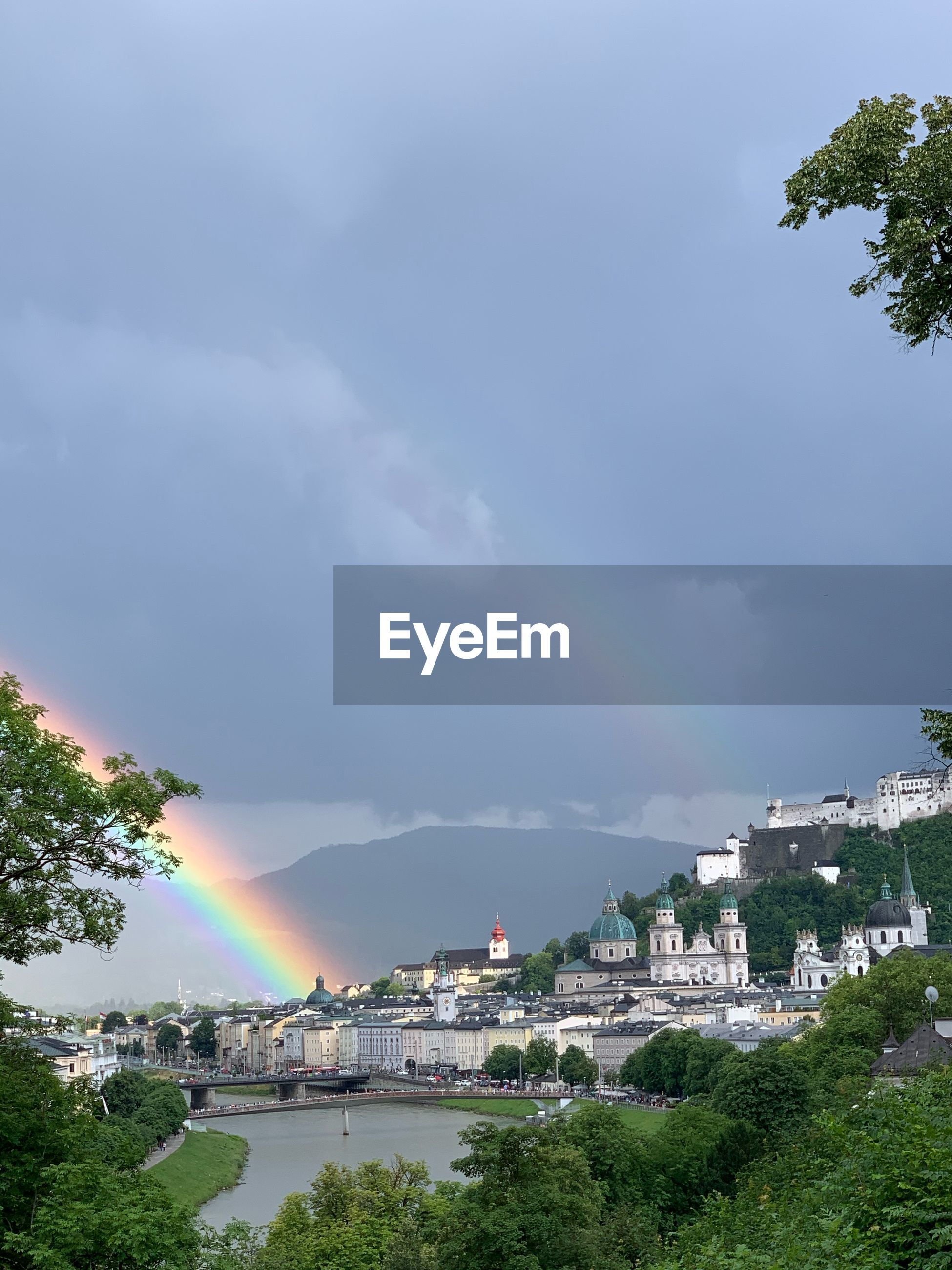 SCENIC VIEW OF RAINBOW OVER BUILDINGS IN CITY