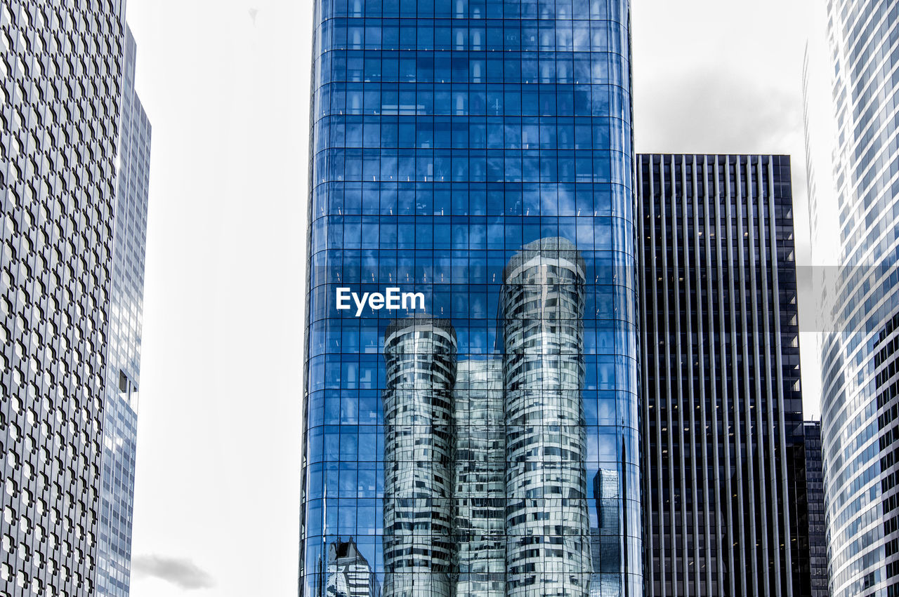 built structure, architecture, modern, office building exterior, building exterior, city, building, skyscraper, office, tall - high, glass - material, no people, reflection, sky, tower, low angle view, day, nature, outdoors, travel destinations, financial district