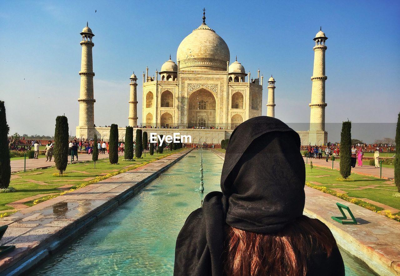 Rear View Of Woman Looking At Taj Mahal