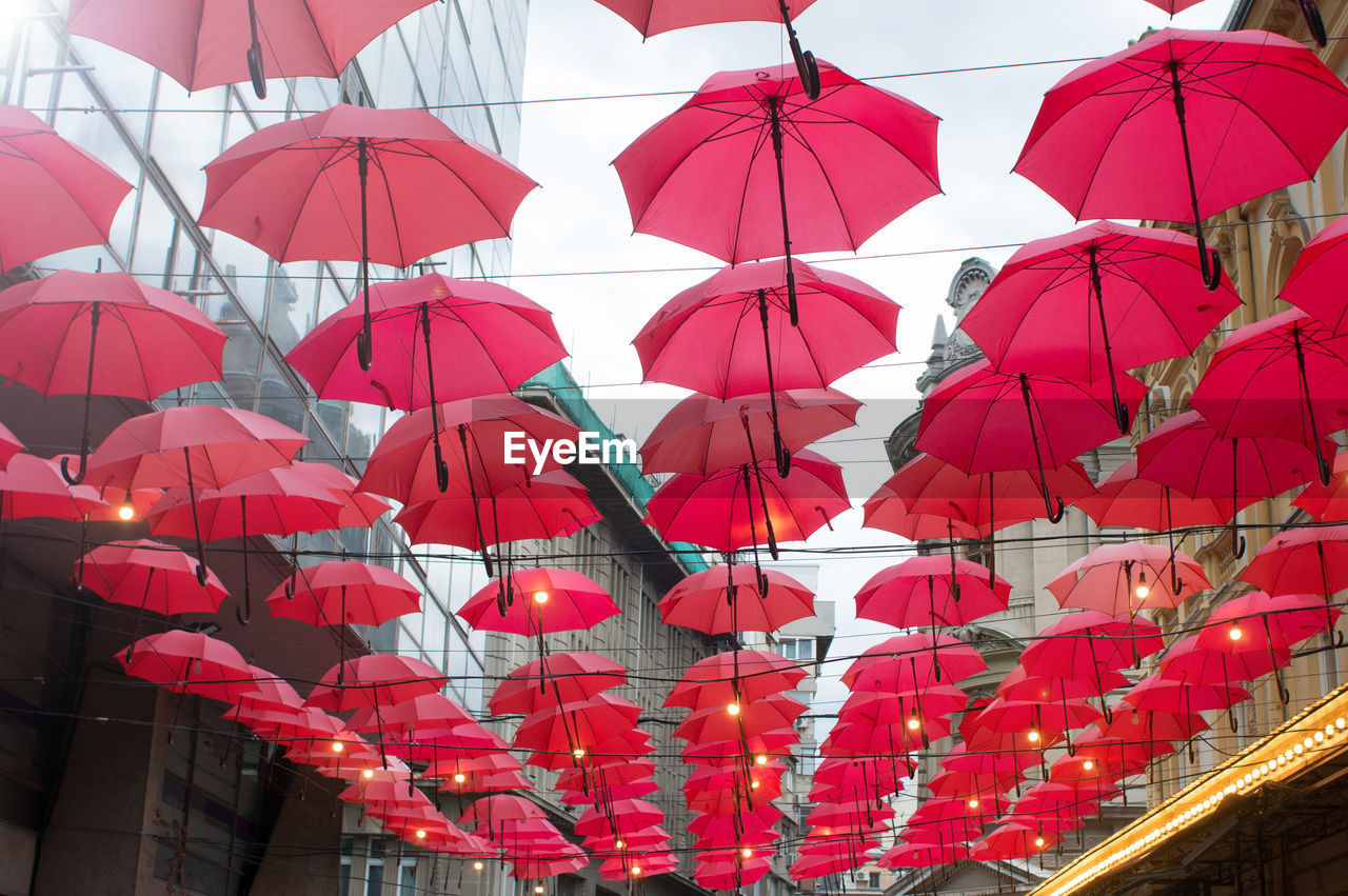 red, decoration, hanging, umbrella, protection, lighting equipment, no people, large group of objects, security, celebration, low angle view, multi colored, in a row, side by side, architecture, abundance, outdoors, chinese lantern, festival