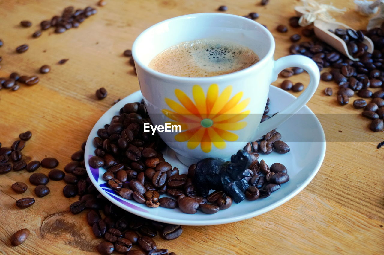 food and drink, freshness, table, coffee - drink, cup, food, coffee, drink, mug, refreshment, coffee cup, roasted coffee bean, still life, high angle view, indoors, flower, close-up, no people, flowering plant, healthy eating, crockery, breakfast