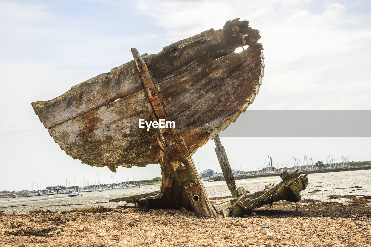 damaged, nautical vessel, abandoned, sky, obsolete, beach, boat, sea, deterioration, wood - material, day, transportation, run-down, no people, nature, outdoors, cloud - sky, sand, bad condition, water, moored, beauty in nature, horizon over water