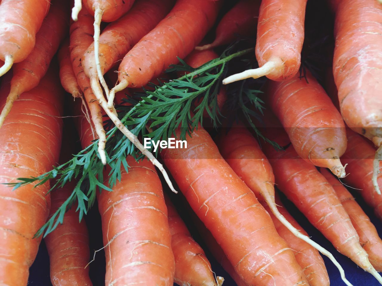 High Angle View Of Carrots For Sale At Market Stall