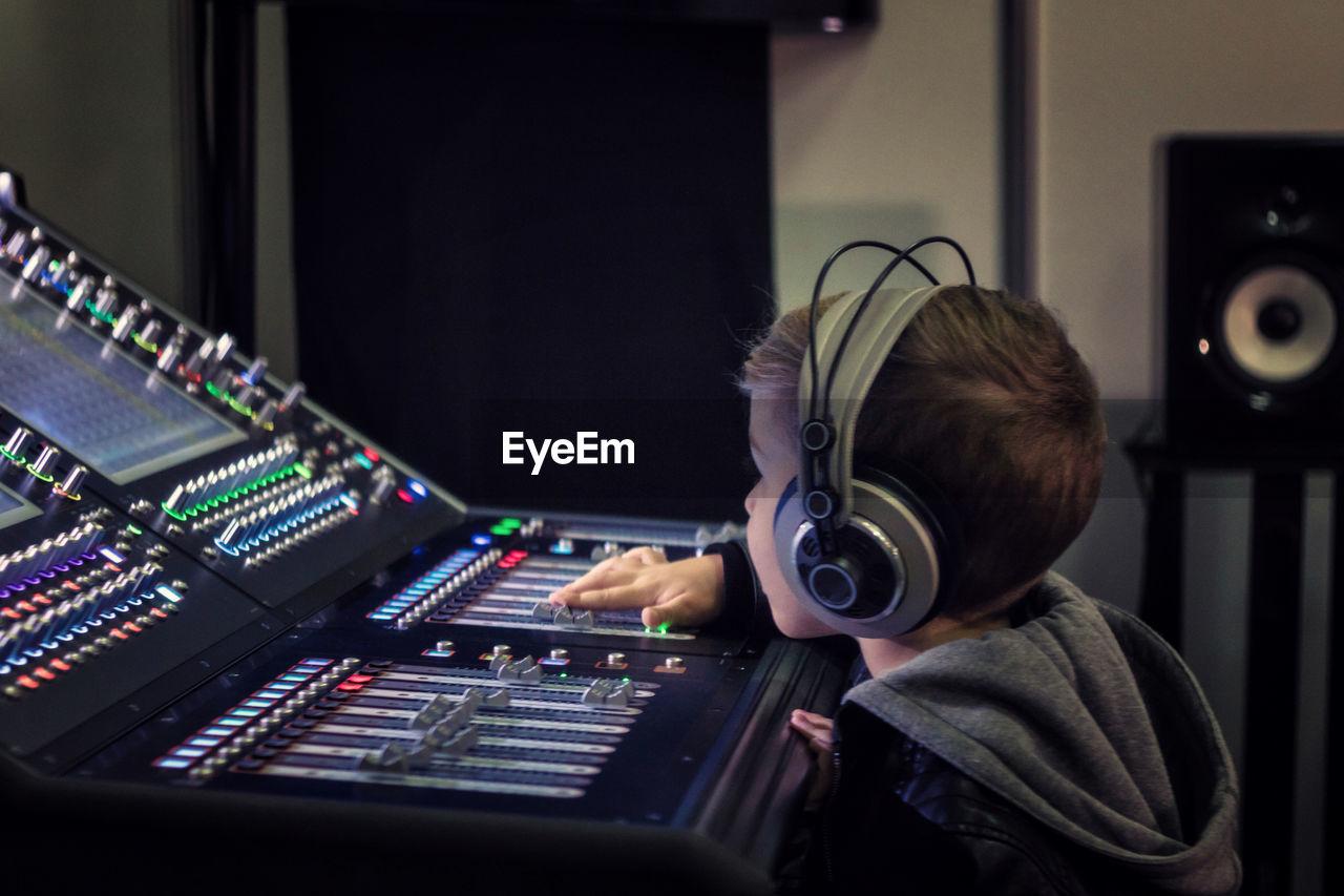Cute Boy Mixing Music In Recording Studio