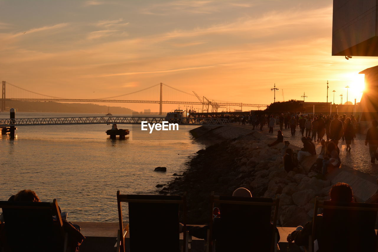sunset, sky, sea, water, built structure, bridge - man made structure, connection, architecture, suspension bridge, outdoors, silhouette, travel destinations, nature, beauty in nature, no people, city, day