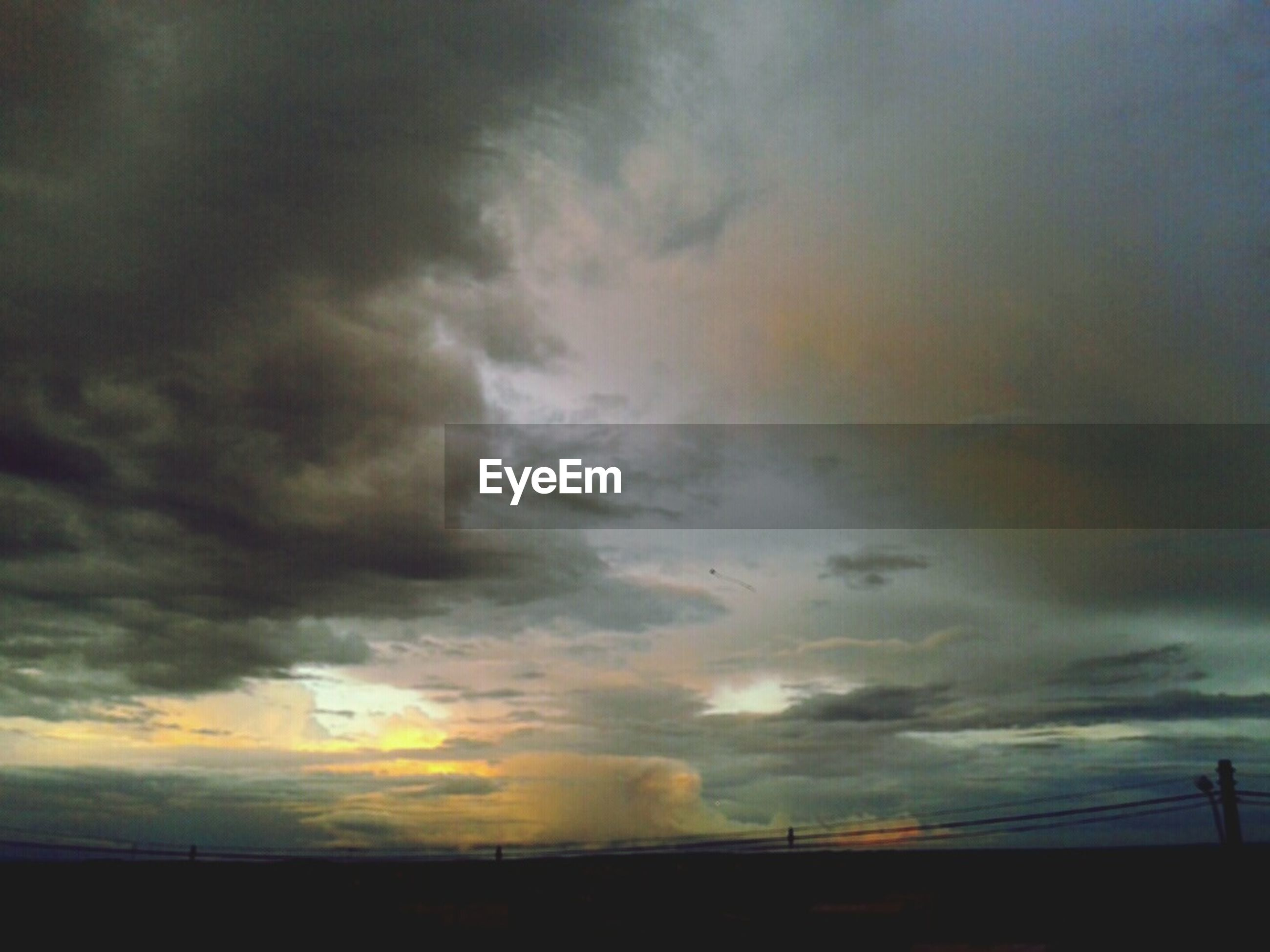 sky, sunset, cloud - sky, cloudy, silhouette, beauty in nature, scenics, tranquility, tranquil scene, weather, low angle view, nature, dramatic sky, cloud, overcast, idyllic, dusk, cloudscape, atmospheric mood, storm cloud