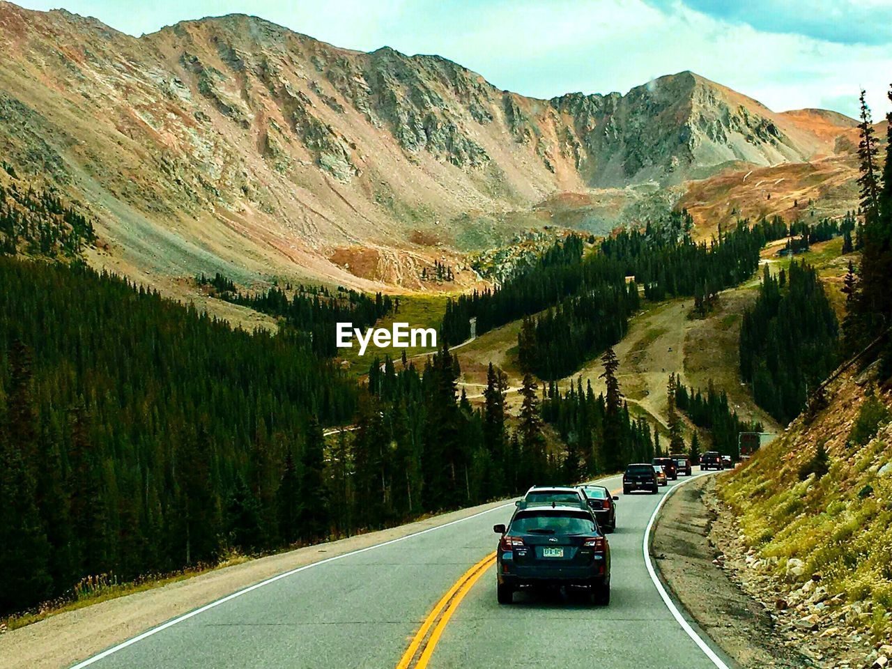 Cars On Road Against Mountains