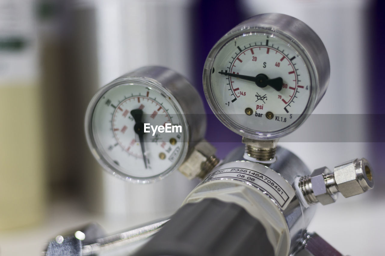 Close-up of pressure gauges in factory