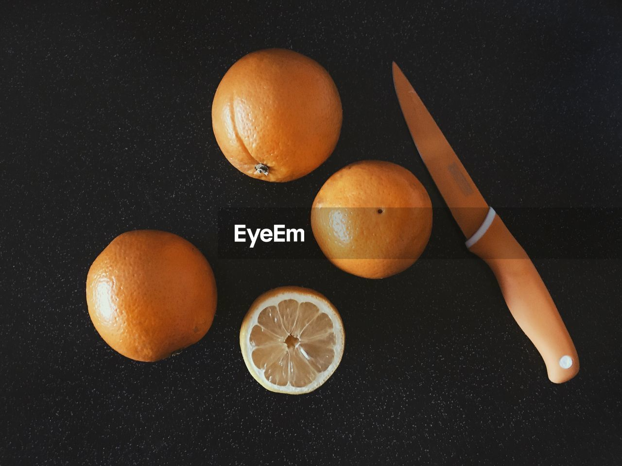 High Angle View Of Oranges And Knife On Table