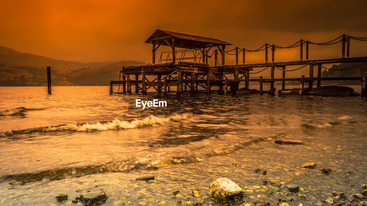 water, sunset, sky, sea, architecture, built structure, nature, orange color, beach, beauty in nature, no people, land, pier, scenics - nature, cloud - sky, outdoors, tranquility, tranquil scene, wave