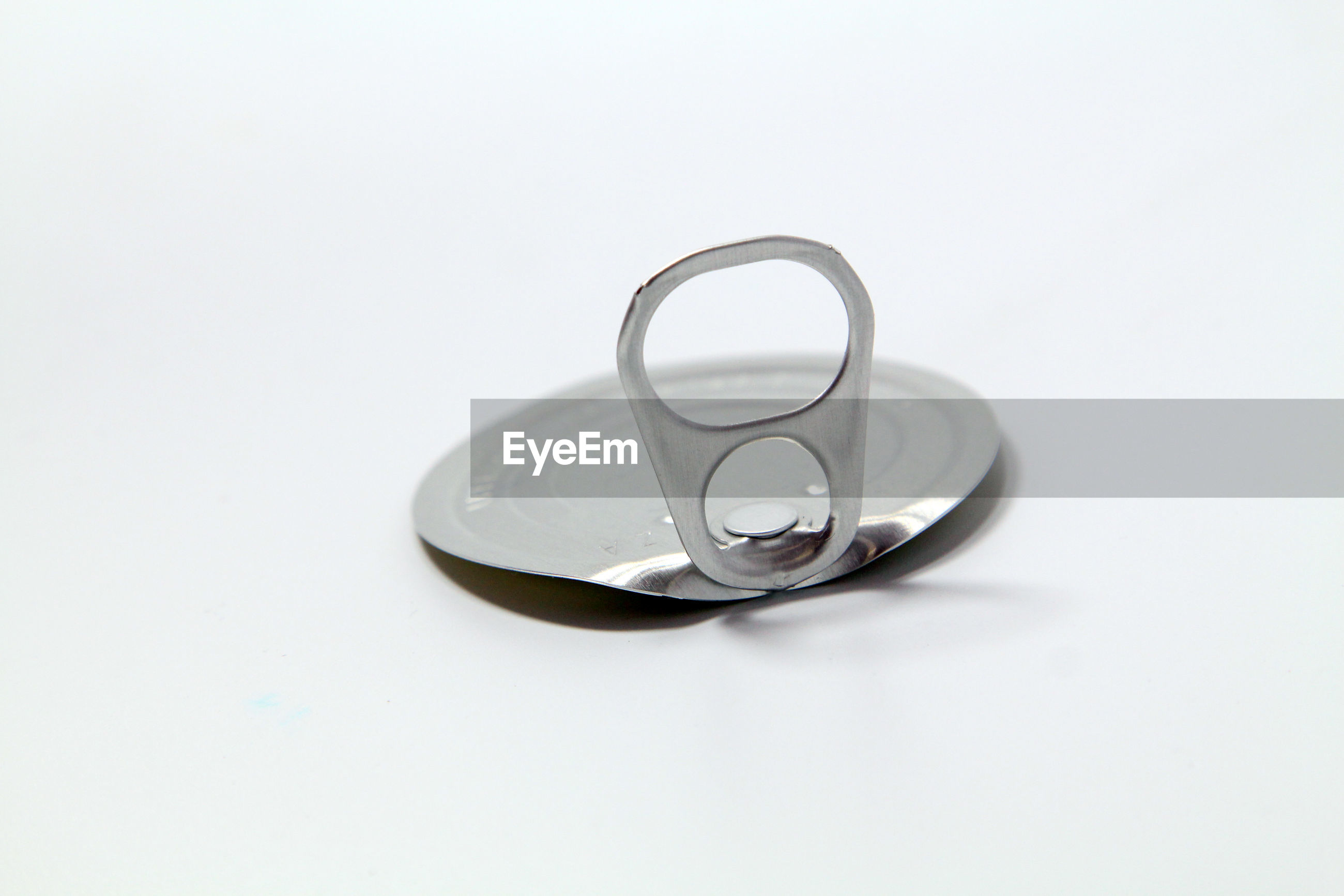 High angle view of tin can cover on gray background