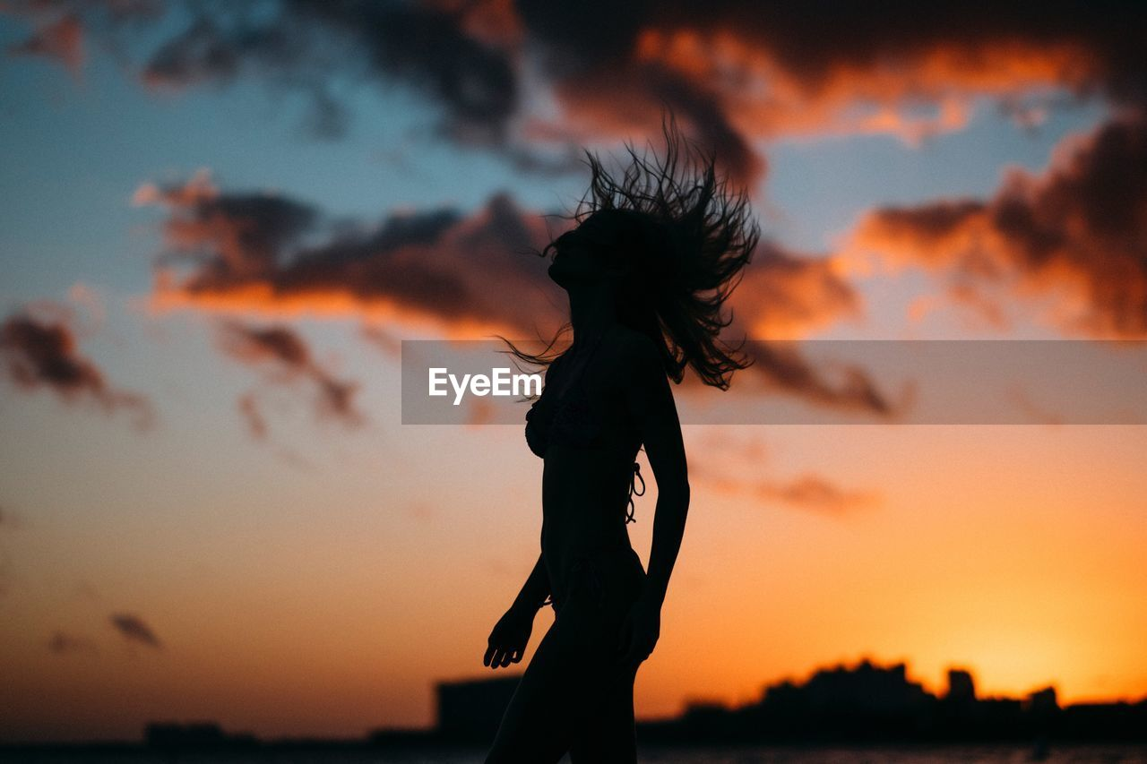 SILHOUETTE WOMAN AGAINST TREE DURING SUNSET
