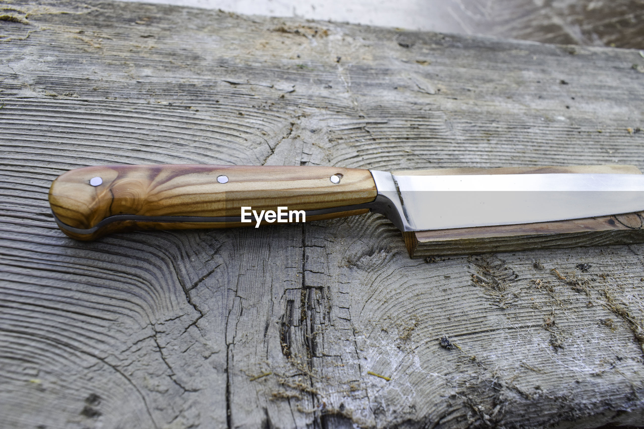 Close-up of knife on table