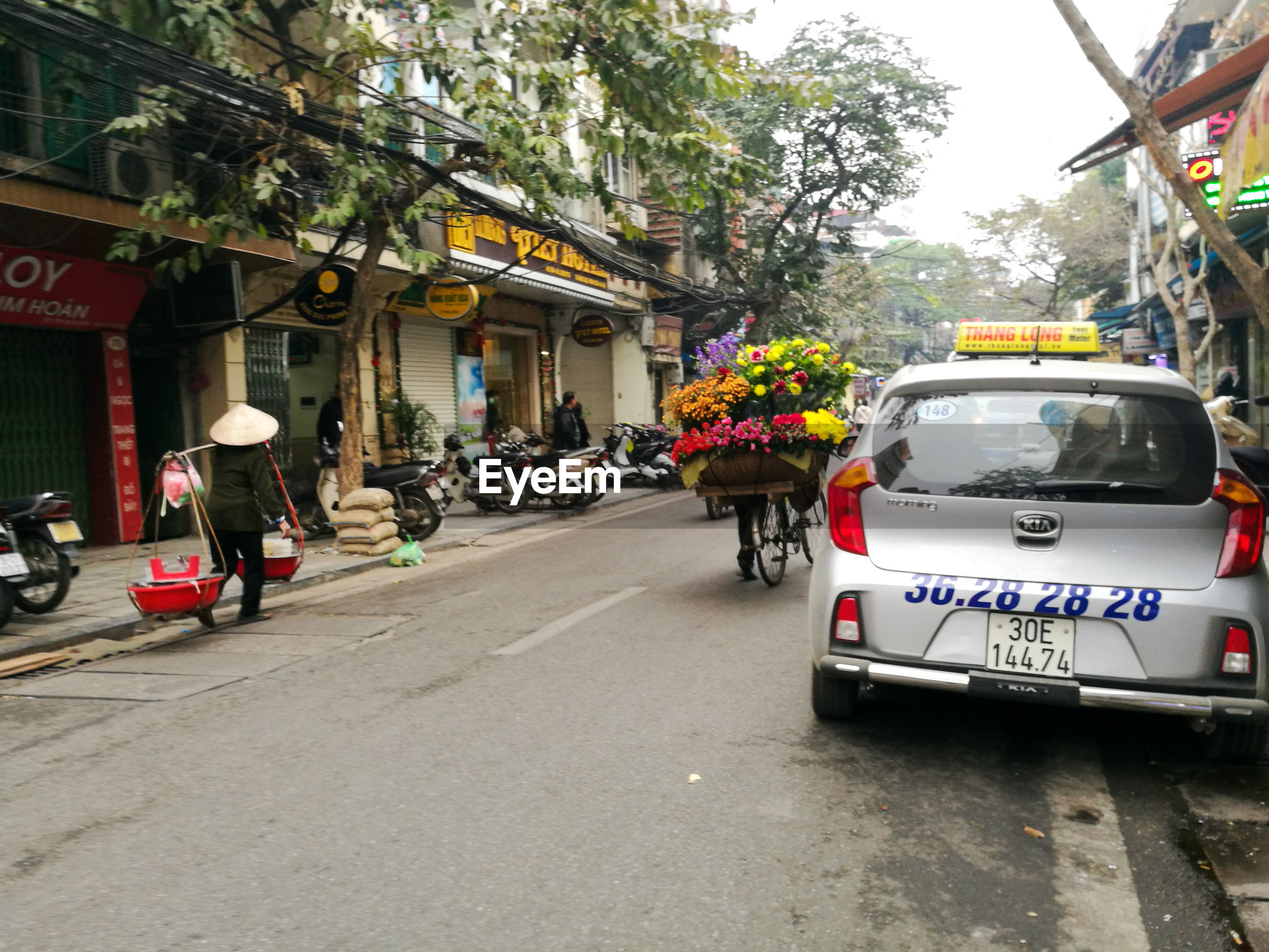 architecture, building exterior, built structure, street, tree, outdoors, day, land vehicle, police force, city, no people