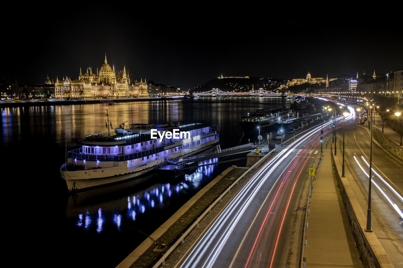 illuminated, architecture, night, built structure, building exterior, city, long exposure, transportation, water, motion, light trail, river, travel destinations, high angle view, bridge, nature, no people, bridge - man made structure, travel, outdoors, chain bridge, government