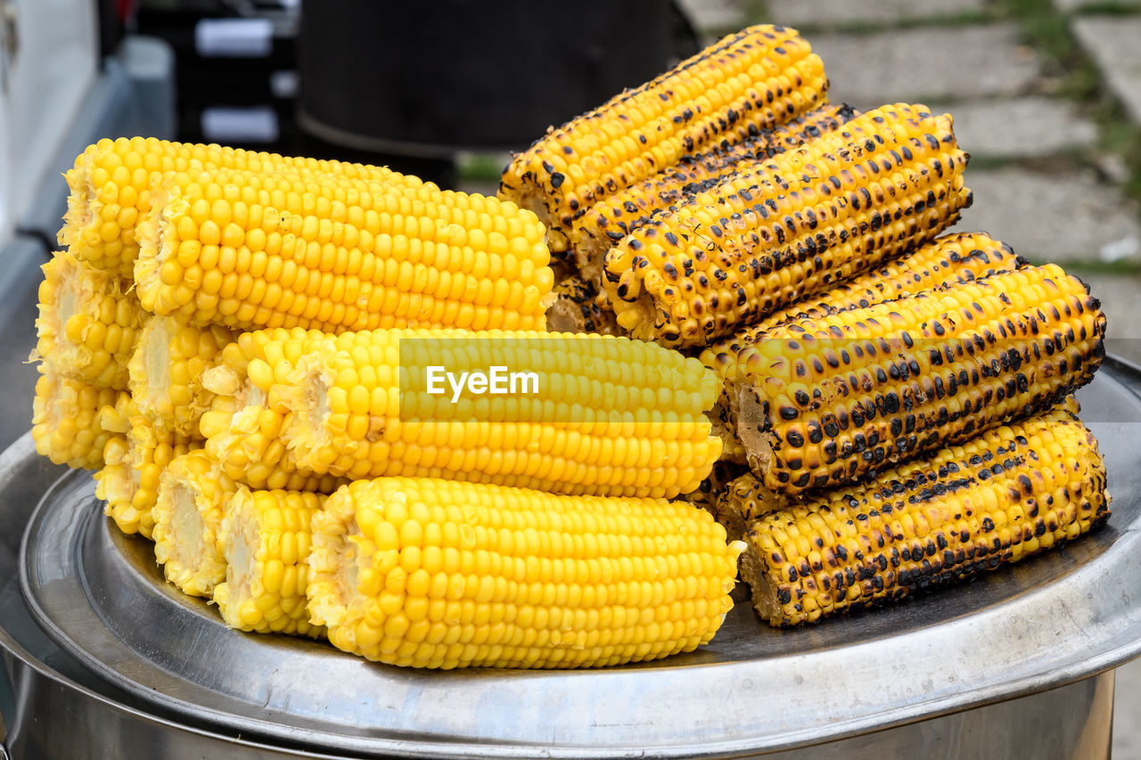 food and drink, corn, food, yellow, sweetcorn, corn on the cob, healthy eating, vegetable, freshness, wellbeing, close-up, stack, no people, focus on foreground, still life, plate, indoors, ready-to-eat, table, day, breakfast, snack, street market